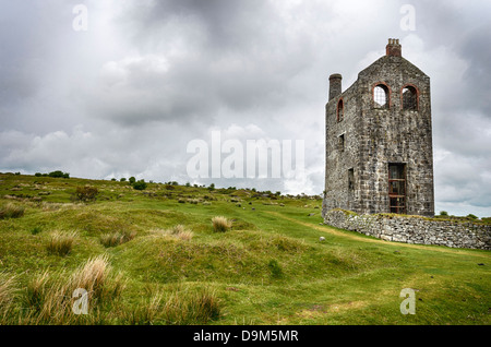 An old ruined engine house left over from Cornish tin and copper mining at Minions on Bodmin Moor in Cornwall - Stock Photo