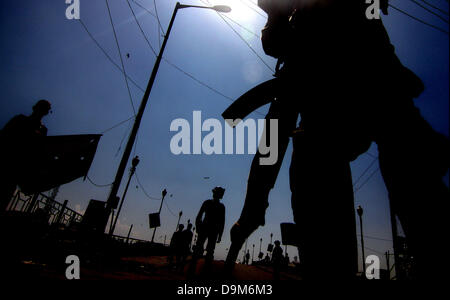 Srinagar, Indian Kashmir. June 22, 2013 - Indian Security personnel keep vigil near the spot after two Indian policemen - Stock Photo
