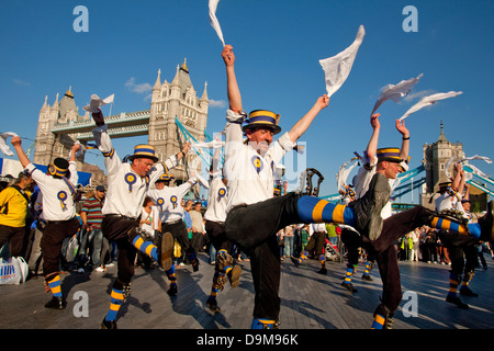 Thames Festival. The Hammersmith Morris Men performing in front of Tower Bridge, London, UK - Stock Photo
