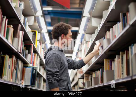 student in book shop or library - Stock Photo
