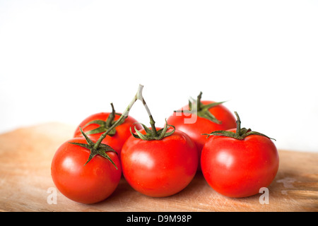 tomatoes in the kitchen isolated on white - Stock Photo