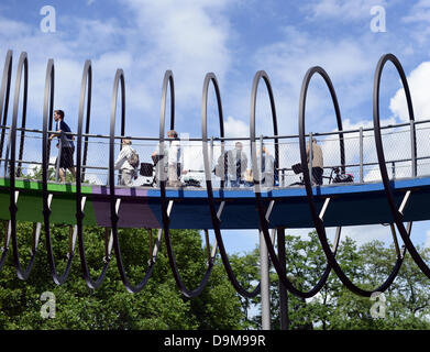Visitors of the international art exhibition Emscherkunst 2013 walk across the 'Slinky Springs to Fame bridge' by - Stock Photo