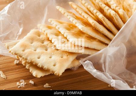 Organic Whole Wheat Soda Crackers ready to eat - Stock Photo
