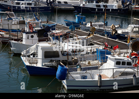 small inshore fishing boats in the port harbour of Cambrils Catalonia Spain - Stock Photo