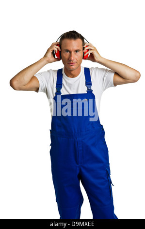 Worker with auditory protection (model release) - Stock Photo