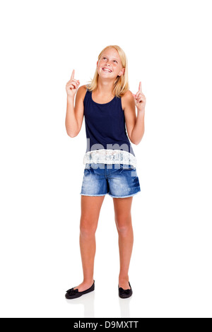 happy pre teen girl pointing up isolated on white - Stock Photo