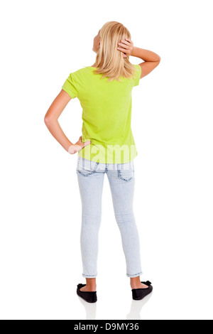rear view of pre teen girl thinking - Stock Photo
