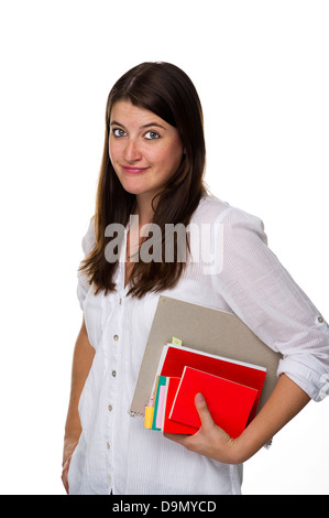 (Model release) Pensive schoolgirl with books under the arm - Stock Photo