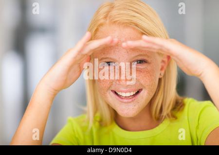 happy pre teen girl looking forward - Stock Photo