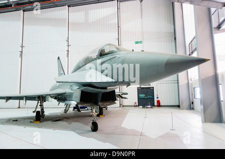 A Typhoon Eurofighter aircraft in a hangar - Stock Photo