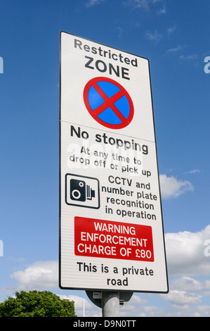 Warning sign to motorists that they are entering a restricted zone at an airport that stopping is not permitted. - Stock Photo