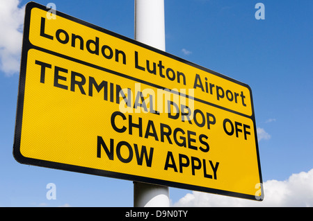 Sign at entrance to Luton Airport warning motorists that terminal drop off charges now apply - Stock Photo