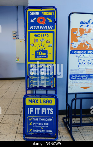 Ryanair bag size guide at the boarding gate in an airport - Stock Photo