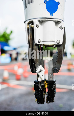 Pincer grip on an 'Andros' remote controlled vehicle (robot), used by the bomb squad for defusing IEDs and suspect - Stock Photo