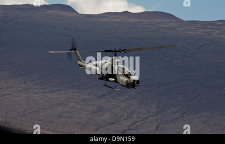 A US Marine Corps AH-1W Super Cobra attack helicopter during a live fire exercise May 15, 2013 at Pohakuloa Training - Stock Photo
