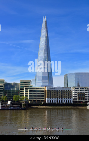 Coxed eight rowing on the River Thames past The Shard, London Bridge Quarter, London, United Kingdom - Stock Photo