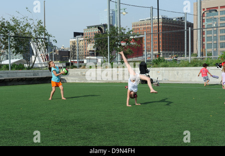 Girls playing in Hudson River Park, in the Tribeca neighborhood of Manhattan. June 22, 2013 - Stock Photo