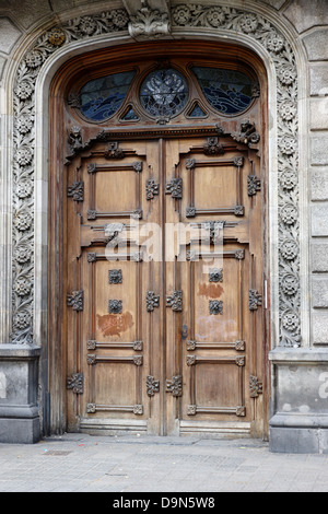 old ornate wooden heavy door in the old city of barcelona catalonia spain - Stock Photo