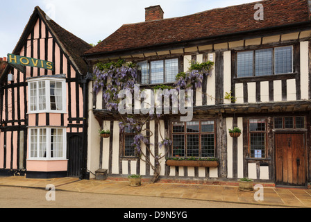 Wisteria floribunda growing on a timbered house front in historic village. Market Place, Lavenham, Suffolk, England, - Stock Photo