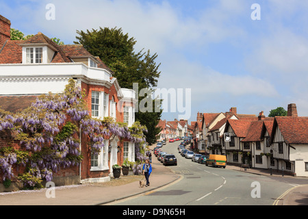 View along the main street in picturesque historic medieval village centre. Lavenham, Suffolk, England, UK, Britain - Stock Photo