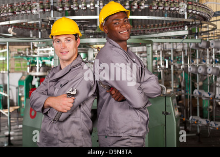 two textile industrial technicians portrait in factory - Stock Photo
