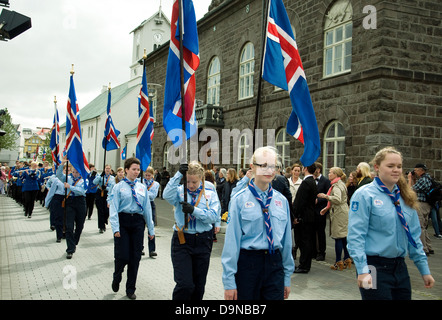 On Iceland's National Day Scouts, male and female, parade with the national flag outside Parliament, or Althing, - Stock Photo