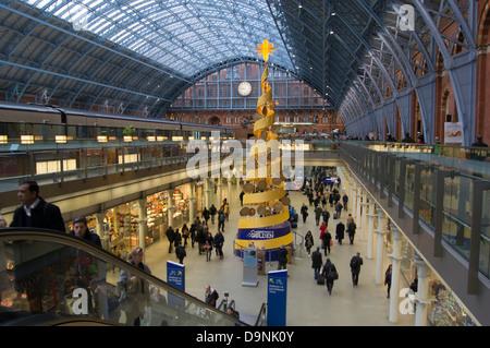 UK, England, London, st pancras station interior Xmas tree - Stock Photo