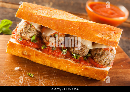 Homemade Spicy Meatball Sub Sandwich with Marinara Sauce and Cheese - Stock Photo