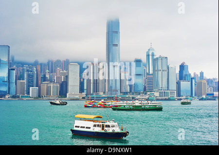A lot of ships in Victoria harbor. View from Kowloon quayside. Hong Kong. - Stock Photo