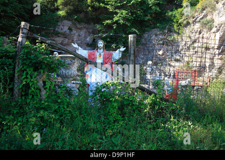 Saints on the road, behind a fence, on the peninsula of Sorrento, Campania, Italy - Stock Photo