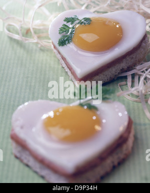Bread with heart-shaped fried egg - Stock Photo