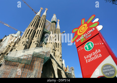 Barcelona City Tour sightseeing bus stop sign for tourists at the Basilica de la Sagrada Familia cathedral in Barcelona, - Stock Photo