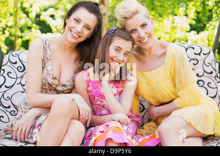 Three happy ladies smiling to the camera - Stock Photo