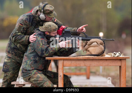 Members of an reservist company of teh German Armed Forces exercise on a shooting range with their assault rifle - Stock Photo