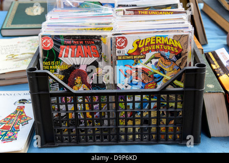 old comic books on sale at a flea market in Nice France on the Cote d'Azur - Stock Photo