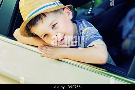 Cute little boy bored in the car - Stock Photo