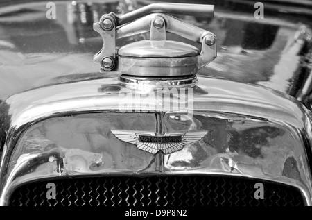 1929 Aston Martin classic vintage car badge motif logo emblem marque brand and radiator cap detail - Stock Photo