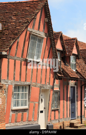Pink timbered cottages in medieval village of Lavenham, Suffolk, England, UK, Britain - Stock Photo
