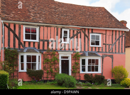 Old Cordwainers cottage pink timbered Tudor house front in medieval village of Lavenham, Suffolk, England, UK, Britain - Stock Photo