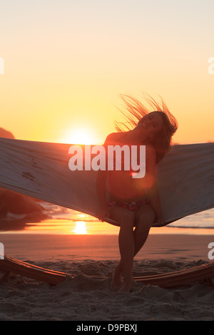 Woman in hammock on the beach - Stock Photo