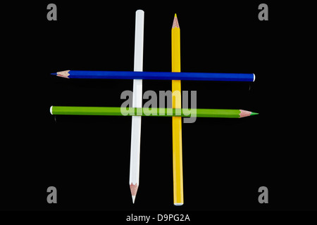 Colored pencils arranged in plus sign - Stock Photo
