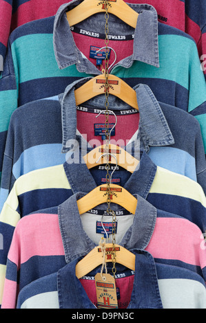 Shirts For Sale in a Clothes Shop - Stock Photo
