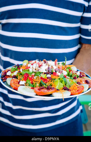 Man holding platter of mexican food - Stock Photo