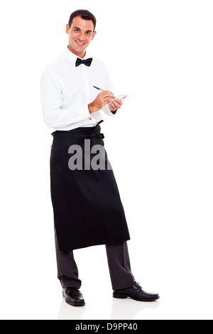 smiling young waiter taking orders - Stock Photo