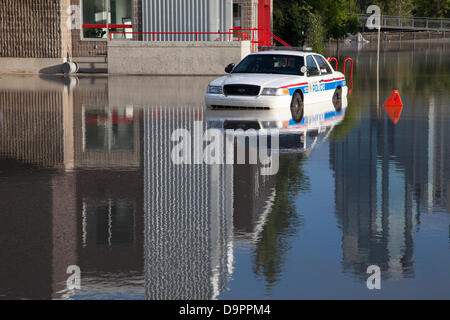 Saturday, June 22, 2013. A police car trapped in a parking lot by rapidly rising floodwaters in the Sunnyside neighbourhood - Stock Photo