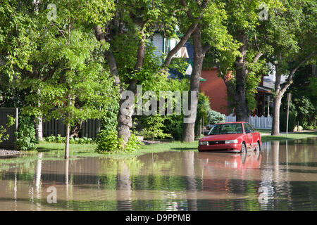 Saturday, June 22, 2013. A car trapped by floodwaters in the Sunnyside neighbourhood of Calgary, Alberta, Canada. - Stock Photo