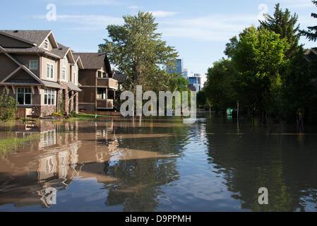 Saturday, June 22, 2013. A flooded street in the Sunnyside neighbourhood of Calgary, Alberta, Canada. Heavy rains - Stock Photo