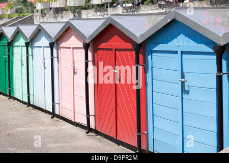 Row of colored beach huts in sunny day. - Stock Photo