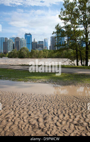 Saturday, June 22, 2013. Memorial Drive, a major road paralleling the Bow River, is covered by sediment and remains - Stock Photo