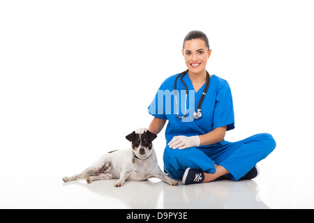 beautiful caring female vet doctor sitting with pet dog - Stock Photo